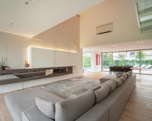 Foto e Idee per Living - living moderno con pareti beige