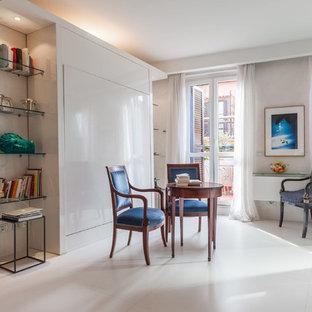 Immagine di un soggiorno contemporaneo di medie dimensioni e chiuso con pareti beige e TV a parete