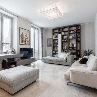 Foto di un soggiorno design con pareti bianche, nessun camino, TV autoportante e pavimento beige