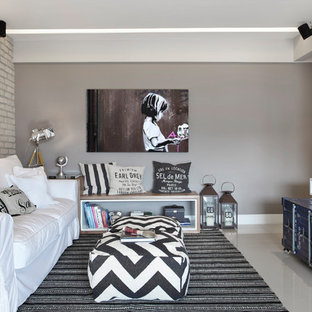 Small urban open concept porcelain floor and beige floor living room photo in Milan with a wall-mounted tv and gray walls