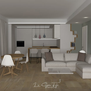 Inspiration for a small modern open concept living room in Other with a library, green walls, porcelain floors, a corner fireplace, a plaster fireplace surround, a wall-mounted tv, beige floor, recessed and wallpaper.