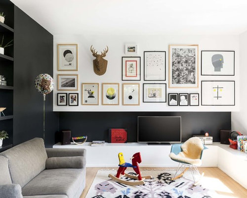 Inspiration For A Scandinavian Enclosed Light Wood Floor Living Room Remodel In Milan With Black Walls