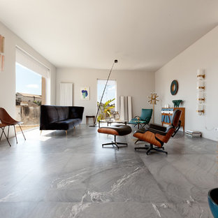 Example of a large midcentury modern open concept marble floor living room design in Milan with white walls