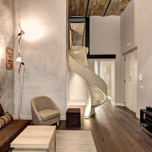 Inspiration for an industrial family room in Rome with grey walls and dark hardwood floors.
