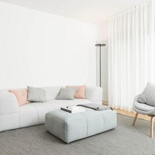 Ispirazione per un soggiorno scandinavo con sala formale, pareti bianche, parquet chiaro e pavimento beige