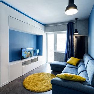 Idee per un soggiorno minimal di medie dimensioni e aperto con pareti blu e TV autoportante