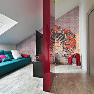 Small trendy open concept porcelain floor and beige floor family room photo in Turin with a wall-mounted tv, no fireplace and multicolored walls
