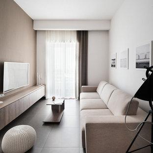 Esempio di un soggiorno minimalista di medie dimensioni con pareti bianche e TV a parete