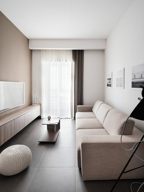 Nice Mid Sized Minimalist Family Room Photo In Naples With White Walls And A Wall