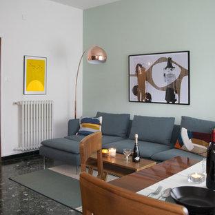 Idee per un soggiorno minimalista di medie dimensioni e chiuso con pareti verdi, pavimento in marmo e pavimento nero