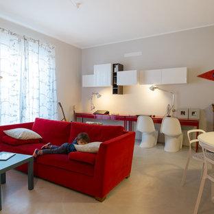 Immagine di un soggiorno minimal aperto con pareti grigie e pavimento in cemento