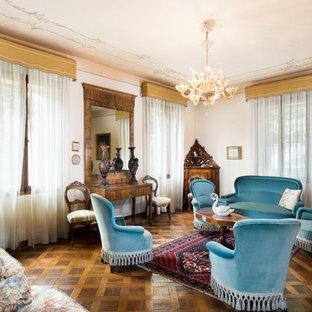 Foto de salón abierto, clásico, sin chimenea y televisor, con paredes rosas y suelo de madera oscura