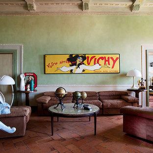 Large eclectic living room in Florence with green walls and brick floors.