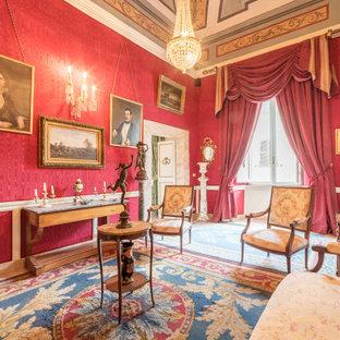 Foto di un soggiorno classico con pareti rosse