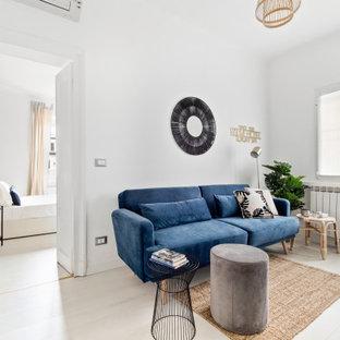 Esempio di un piccolo soggiorno contemporaneo aperto con pareti bianche, pavimento in laminato e pavimento bianco