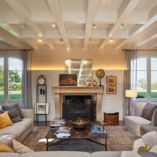 Immagine di un soggiorno contemporaneo aperto con camino classico, pareti beige, parquet scuro e pavimento marrone