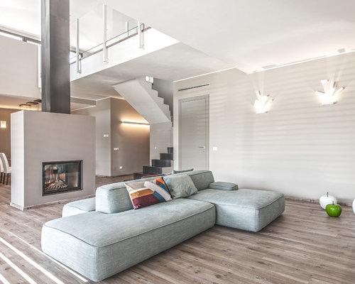 Foto e idee per soggiorni soggiorno con camino bifacciale for Soggiorno con camino