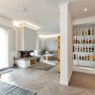 Ispirazione per un soggiorno minimal di medie dimensioni con pareti bianche, parquet chiaro, camino ad angolo e cornice del camino in intonaco
