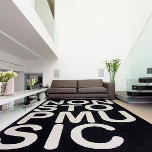 Idee per un grande soggiorno minimal stile loft con pareti bianche