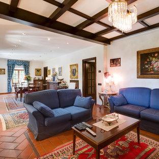 Elegant terra-cotta floor living room photo in Rome with white walls