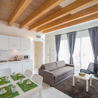 Esempio di un soggiorno contemporaneo di medie dimensioni e aperto con pareti bianche