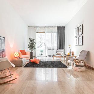 Immagine di un soggiorno design con pavimento in marmo e pareti bianche