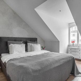 Idéer för nordiska sovrum, med grå väggar och ljust trägolv