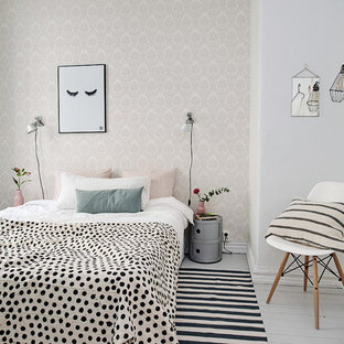 Medium sized scandinavian master bedroom in Gothenburg with white walls, painted wood flooring and no fireplace.