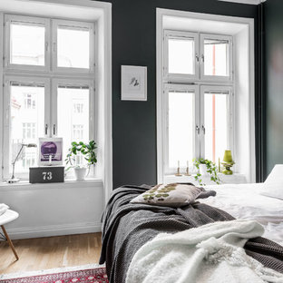 Inspiration for a medium sized scandi master bedroom in Gothenburg with medium hardwood flooring, brown floors and green walls.