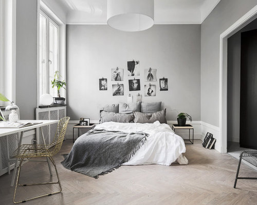 mid sized danish master bedroom photo in other with gray walls and