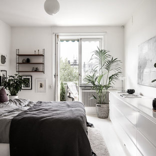Design ideas for a scandi bedroom in Stockholm with white walls and white floors.