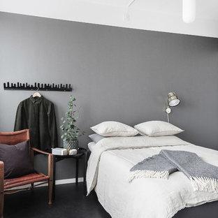 Foto på ett skandinaviskt gästrum, med grå väggar och svart golv