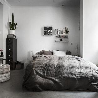 Idéer för nordiska sovrum, med vita väggar och betonggolv