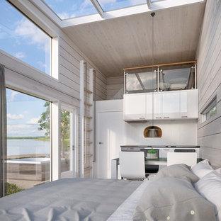 Idéer för att renovera ett mellanstort skandinaviskt sovrum, med vita väggar