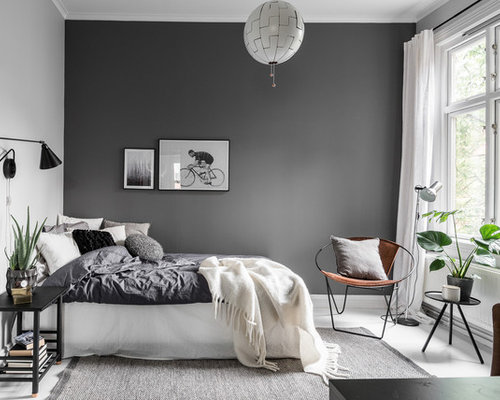 Inspiration For A Mid Sized Scandinavian Master Painted Wood Floor Bedroom Remodel In Gothenburg With