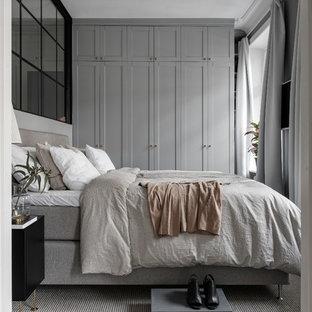Foto på ett minimalistiskt sovrum