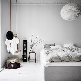 Inspiration for a scandinavian master bedroom in Gothenburg with white walls, painted wood flooring, no fireplace and white floors.