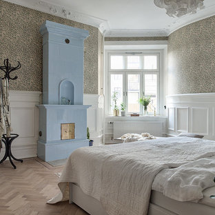 Bedroom - mid-sized victorian master light wood floor bedroom idea in Gothenburg with multicolored walls and no fireplace