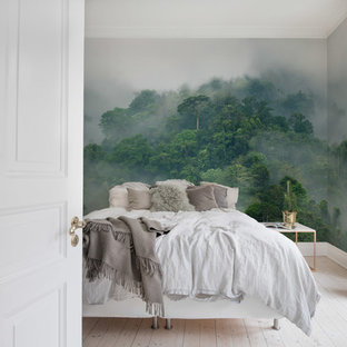 Tropical bedroom in Gothenburg with green walls, painted wood floors and white floor.