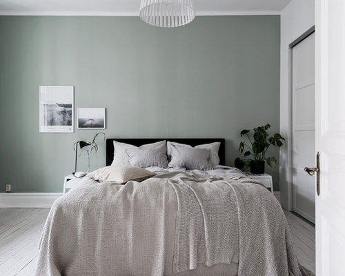 Large Danish Master Light Wood Floor And White Floor Bedroom Photo In  Gothenburg With Green Walls