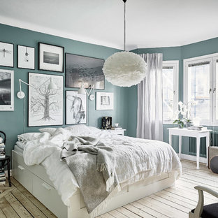 Design Ideas For A Large Scandinavian Master Bedroom In Gothenburg With Blue Walls Light Hardwood
