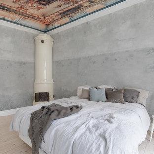 Modelo de dormitorio minimalista con estufa de leña