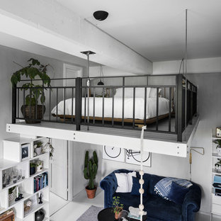 Inspiration for a scandinavian loft-style bedroom in Stockholm with grey walls, painted wood floors and white floor.