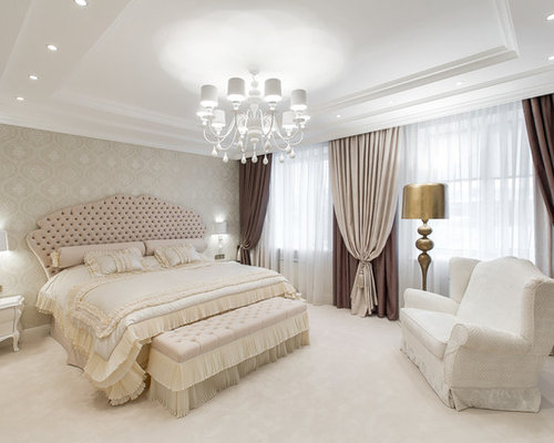 inspiration for a large timeless master carpeted bedroom remodel in other with beige walls
