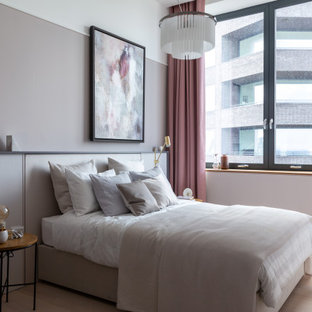 Design ideas for a contemporary bedroom in London with grey walls, light hardwood flooring and beige floors.