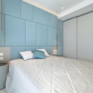 Idee per una camera degli ospiti contemporanea di medie dimensioni con pavimento bianco