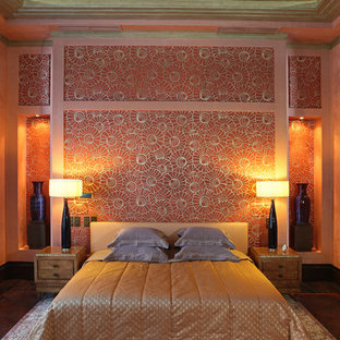 Design ideas for a large modern master bedroom in Moscow with orange walls and dark hardwood floors.