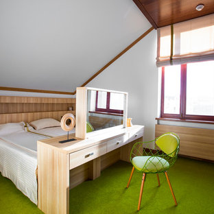 This is an example of a contemporary bedroom in Moscow with white walls and green floor.