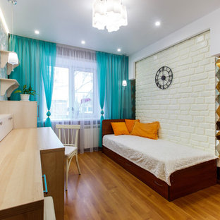 Bedroom - small eclectic master laminate floor and orange floor bedroom idea in Other with multicolored walls