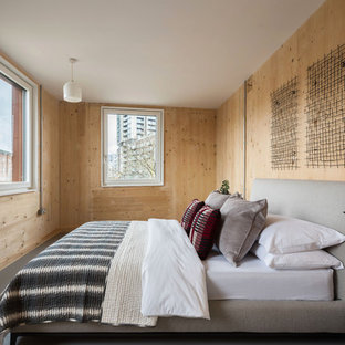 Design ideas for a medium sized scandinavian guest bedroom in London with beige walls, grey floors and lino flooring.